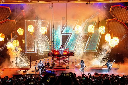 Tommy Thayer, Gene Simmons, Eric Singer, Paul Stanley. Gene Simmons, from left, Eric Singer, Paul Stanley and Tommy Thayer of KISS perform at the Riverbend Music Center, in Cincinnati