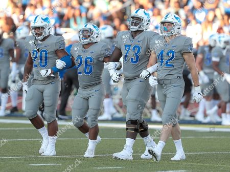 Stock Photo of Buffalo Bulls game captains linebacker James Patterson (20), running back Jaret Patterson (26), offensive lineman Kayode Awosika (73), and linebacker Matt Otwinowski (42) make their way to midfield for the coin toss before the NCAA Football game between the Robert Morris Colonials and Buffalo Bulls at UB Stadium in Amherst, N.Y. (Nicholas T