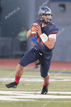 Robert Morris Colonials quarterback George Martin (17) scrambles with the ball during the first half of play in the NCAA Football game between the Robert Morris Colonials and Buffalo Bulls at UB Stadium in Amherst, N.Y. (Nicholas T