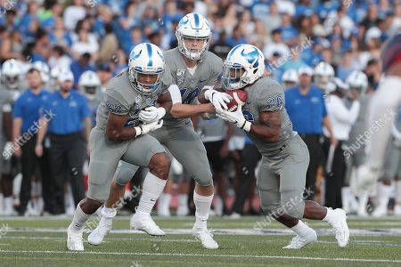 Buffalo Bulls quarterback Matt Myers (10) hands the ball off to running back Jaret Patterson (26) while Buffalo Bulls running back Ron Cook Jr. (23) runs some trickery during the first half of play in the NCAA Football game between the Robert Morris Colonials and Buffalo Bulls at UB Stadium in Amherst, N.Y. (Nicholas T