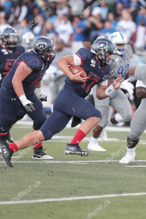 Stock Image of Robert Morris Colonials quarterback George Martin (17) rushes the ball during the first half of play in the NCAA Football game between the Robert Morris Colonials and Buffalo Bulls at UB Stadium in Amherst, N.Y. (Nicholas T