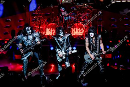 Stock Picture of Gene Simmons, Tommy Thayer, Eric Singer, Paul Stanley. Gene Simmons, from left, Tommy Thayer, Eric Singer and Paul Stanley of KISS perform at the Riverbend Music Center, in Cincinnati, OH