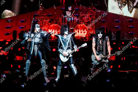 Stock Photo of Gene Simmons, Tommy Thayer, Eric Singer, Paul Stanley. Gene Simmons, from left, Tommy Thayer, Eric Singer and Paul Stanley of KISS perform at the Riverbend Music Center, in Cincinnati, OH