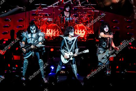 Stock Picture of Gene Simmons, Tommy Thayer, Eric Singer, Paul Stanley. Gene Simmons, from left, Eric Singer, Tommy Thayer and Paul Stanley of KISS perform at the Riverbend Music Center, in Cincinnati, OH