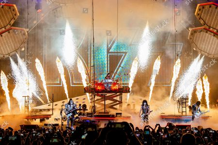 Gene Simmons, Tommy Thayer, Eric Singer, Paul Stanley. Gene Simmons, from left, Eric Singer, Paul Stanley, and Tommy Thayer of KISS perform at the Riverbend Music Center, in Cincinnati, OH