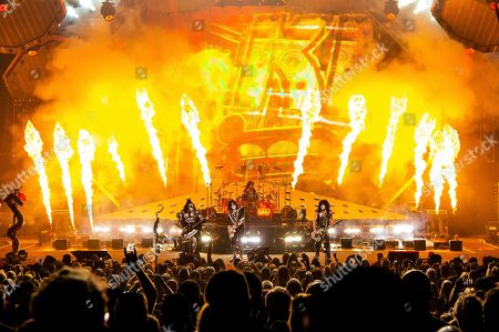 Gene Simmons, Tommy Thayer, Eric Singer, Paul Stanley. Gene Simmons, from left, Eric Singer, Tommy Thayer and Paul Stanley of KISS perform at the Riverbend Music Center, in Cincinnati, OH