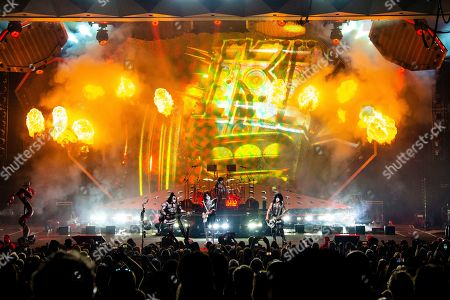 Gene Simmons, Tommy Thayer, Eric Singer, Paul Stanley. Gene Simmons, from left, Tommy Thayer, Eric Singer, and Paul Stanley of KISS perform at the Riverbend Music Center, in Cincinnati, OH