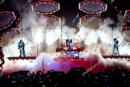 Gene Simmons, Tommy Thayer, Eric Singer, Paul Stanley. Gene Simmons, from left, Paul Stanley, Eric Singer and Tommy Thayer of KISS perform at the Riverbend Music Center, in Cincinnati, OH