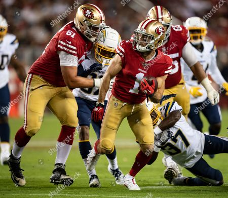 San Francisco 49ers wide receiver Shawn Poindexter (1) breaks through the Charger defense with help from center Wesley Johnson (61), during a NFL preseason game between the Los Angeles Chargers and the San Francisco 49ers at the Levi's Stadium in Santa Clara, California