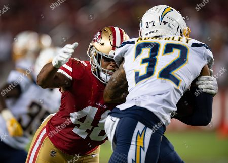 Stock Image of San Francisco 49ers corner back Dontae Johnson (48) tackles Los Angeles Chargers safety Nasir Adderley (32), during a NFL preseason game between the Los Angeles Chargers and the San Francisco 49ers at the Levi's Stadium in Santa Clara, California