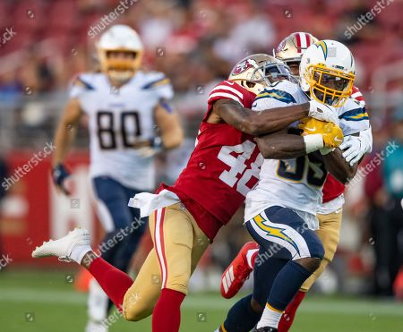 Los Angeles Chargers running back Troymaine Pope (35) is tackled by San Francisco 49ers defensive back Dontae Johnson (48) , during a NFL preseason game between the Los Angeles Chargers and the San Francisco 49ers at the Levi's Stadium in Santa Clara, California