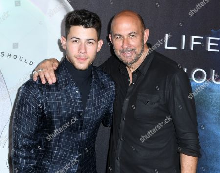 Stock Photo of Nick Jonas, John Varvatos