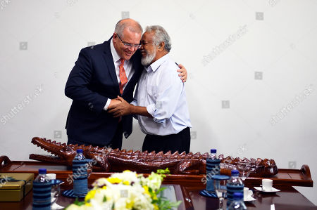 Australian Prime Minister Scott Morrison (L) embraces former Prime Minister of East Timor Xanana Gusmao (R) after receiving a crocodile carved from wood in Dili, East Timor, 30 August 2019. Morrison is visiting the country to attend the 20th anniversary of the signing of the Independence referendum.