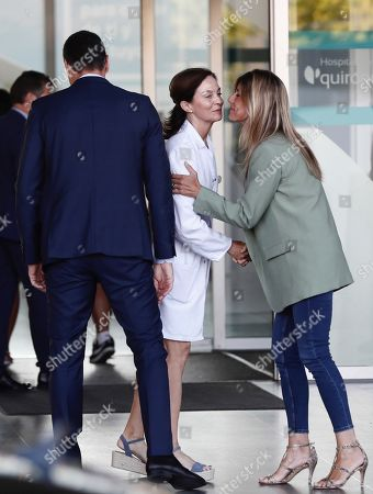 Acting Spanish Prime Minister Pedro Sanchez (L) and his wife Begona Lopez arrive to visit Spanish Emeritus King Juan Carlos at Quiron Hospital in Pozuelo de Alarcon, Madrid, Spain, 30 August 2019. Emeritus king Juan Carlos recovers in hospital from a triple bypass surgery that was performed on 24 August.