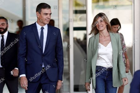 Acting Spanish Prime Minister Pedro Sanchez (L) and his wife Begona Lopez (R)  leave after visiting Spanish Emeritus King Juan Carlos at Quiron Hospital in Pozuelo de Alarcon, Madrid, Spain, 30 August 2019. Emeritus king Juan Carlos recovers in hospital from a triple bypass surgery that was performed on 24 August.