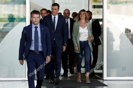 Acting Spanish Prime Minister Pedro Sanchez (2-L) and his wife Begona Lopez (R)  leave after visiting Spanish Emeritus King Juan Carlos at Quiron Hospital in Pozuelo de Alarcon, Madrid, Spain, 30 August 2019. Emeritus king Juan Carlos recovers in hospital from a triple bypass surgery that was performed on 24 August.