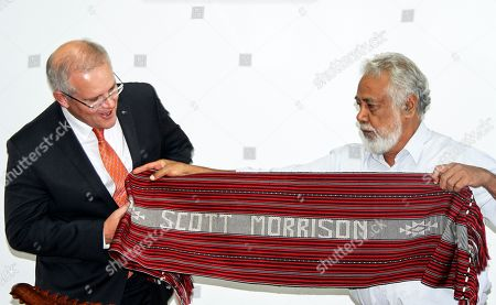 Former Prime Minister of East Timor Xanana Gusmao (R) hands a gift for Australian Prime Minister Scott Morrison (L) during their meeting in Dili, East Timor, also known as Timor-Leste, 30 August 2019. Morrison is in East Timor to attend a celebration of the 20th anniversary of the initiation of the independence referendum (popular consultation) and the arrival of International Force East Timor (INTERFET) - a multinational peacemaking taskforce - in Timor-Leste.