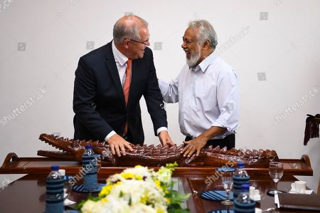 Australian Prime Minister Scott Morrison (L) embraces former Prime Minister of East Timor Xanana Gusmao (R) after receiving a crocodile carved from wood in Dili, East Timor, also known as Timor-Leste, 30 August 2019. Morrison is in East Timor to attend a celebration of the 20th anniversary of the initiation of the independence referendum (popular consultation) and the arrival of International Force East Timor (INTERFET) - a multinational peacemaking taskforce - in Timor-Leste.
