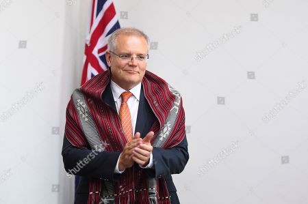 Australian Prime Minister Scott Morrison is seen with a traditional Timorese scarf during a meeting with former Prime Minister of East Timor Xanana Gusmao in Dili, East Timor, also known as Timor-Leste, 30 August 2019 (issued 31 August 2019). Morrison is in East Timor to attend a celebration of the 20th anniversary of the initiation of the independence referendum (popular consultation) and the arrival of International Force East Timor (INTERFET) - a multinational peacemaking taskforce - in Timor-Leste.