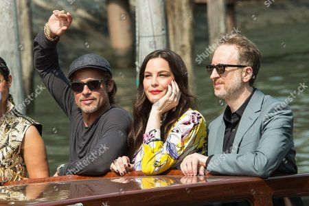 Brad Pitt, Liv Tyler, James Gray. Actors from left, Brad Pitt, Liv Tyler and director James Gray pose for photographers upon arrival for the photo call of the film 'Ad Astra' at the 76th edition of the Venice Film Festival in Venice, Italy
