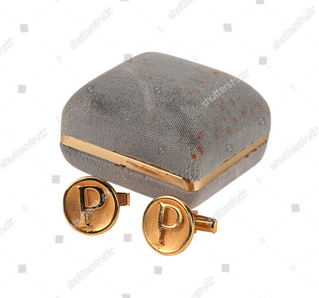 Austin Powers' (Mike Myers) cufflinks from Jay Roach's spy-comedy sequel Austin Powers: The Spy Who Shagged Me. Estimate: £400 - £600.