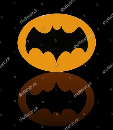 Batman's (Adam West) Batsuit chest emblem from William Dozier's superhero comedy TV series Batman. Estimate: £5000 - £7000.