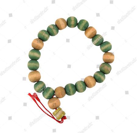 Bruce Nolan's (Jim Carrey) prayer beads from Tom Shadyac's fantasy comedy Bruce Almighty. Estimate: £1000 - £1500.