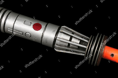 Stock Image of Darth Maul's (Ray Park) lightsaber with close-action fighting blades from Star Wars: The Phantom Menace. Estimate: £30000 - £50000.