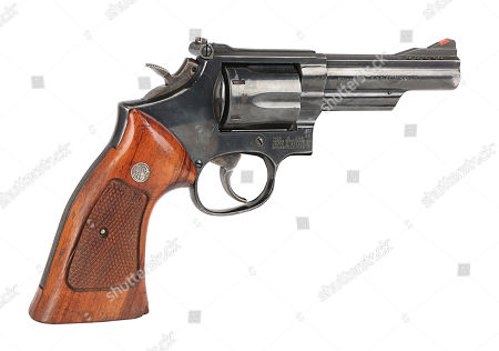 Stock Photo of Detective Roger Murtaugh's (Danny Glover) Smith & Wesson revolver from Richard Donner's buddy-cop action films Lethal Weapon and Lethal Weapon 2. Estimate: £6000 - £8000.