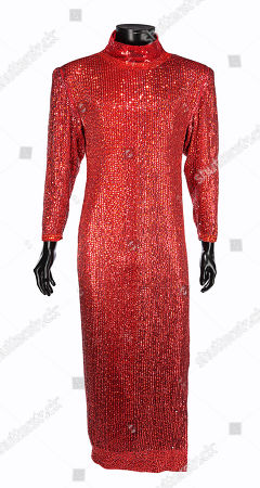 Stock Photo of Dorothy Michaels' (Dustin Hoffman) red sequined dress from Sydney Pollack's Academy Award-nominated comedy Tootsie. Estimate: £8000 - £12000.