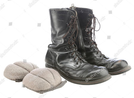 Stock Picture of Egon Spengler's (Harold Ramis) Boots and Elbow pads from Ivan Reitman's supernatural comedy Ghostbusters. Estimate: £3000 - £5000.