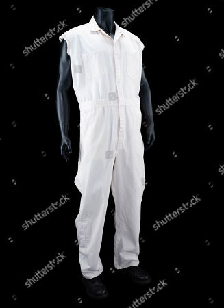 """Jeff """"The Dude"""" Lebowski's (Jeff Bridges) coveralls and boots from Joel and Ethan Coen's comedy The Big Lebowski. Estimate: £5000 - £7000."""