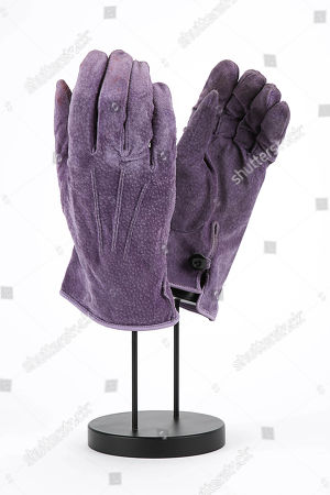 Joker's (Jack Nicholson) purple suede gloves from Tim Burton's superhero film Batman. Estimate: £2000 - £3000.
