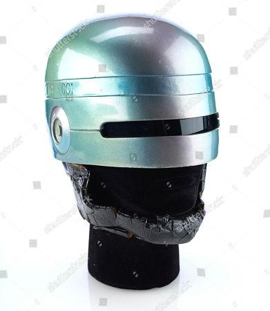 Stock Picture of Robocop's (Peter Weller) helmet from Irvin Kershner's sci-fi action sequel Robocop 2. Estimate: £8000 - £10000.
