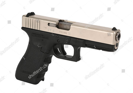 The Joker's (Heath Ledger) Glock pistol from Christopher Nolan's Academy Award-winning action thriller The Dark Knight. Estimate: £10000 - £15000.
