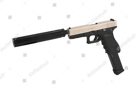 Stock Picture of The Joker's (Heath Ledger) Glock pistol from Christopher Nolan's Academy Award-winning action thriller The Dark Knight. Estimate: £10000 - £15000.