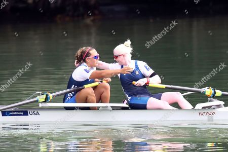 Molly Moore and Jaclyn Smith, right, of the United States celebrate after winning the PR3 Women's Pair final at the World Rowing Championships in Ottensheim, near Linz, Austria