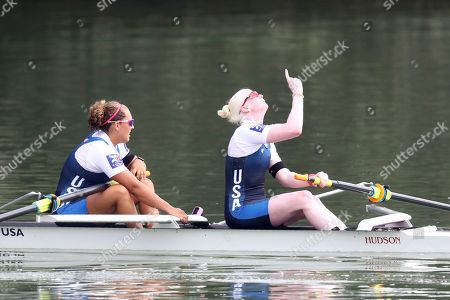 Molly Moore and Jaclyn Smith, right, of the United States react after winning the PR3 Women's Pair final at the World Rowing Championships in Ottensheim, near Linz, Austria