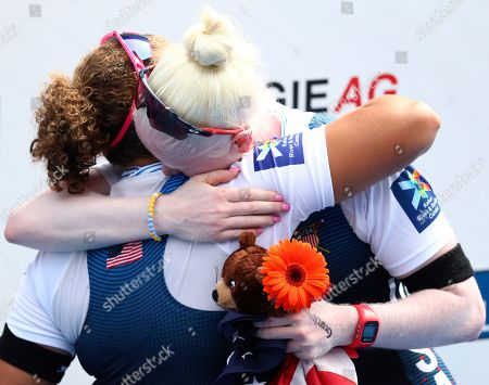Molly Moore and Jaclyn Smith, right, of the United States hug each other on the podium after winning the PR3 Women's Pair final at the World Rowing Championships in Ottensheim, near Linz, Austria