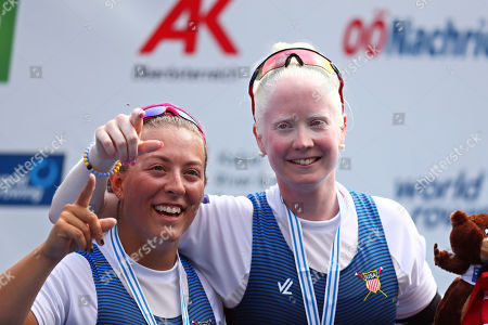 Molly Moore and Jaclyn Smith, right, of the United States pose on the podium after winning the PR3 Women's Pair final at the World Rowing Championships in Ottensheim, near Linz, Austria