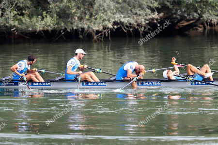 Stock Image of Lorenzo Fontana, Alfonso Scalzone, Catello Amarante II and Gabriel Soares, from left to right, of Italy react after finishing third in the Lightweight Men's Quadruple Sculls final at the World Rowing Championships in Ottensheim, near Linz, Austria