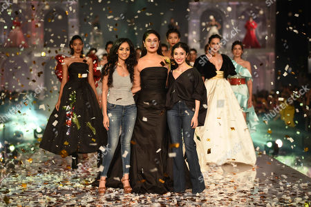 Bollywood actor Kareena Kapoor Khan with designers Gauri and Nainika on the catwalk