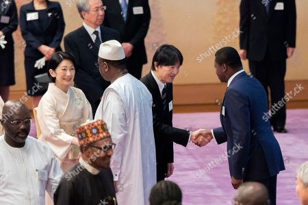 Stock Picture of In this photo released by the Imperial Household Agency of Japan, Japan's Crown Prince Akishino, second from right, and Crown Princess Kiko, left, greet leaders of African nations during an imperial tea party on the sideline of the seventh Tokyo International Conference on African Development (TICAD7) at the Imperial Palace in Tokyo