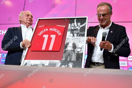Bayern Munich's president Uli Hoeness (L) receives a farewell gift from Bayern's chairman Karl-Heinz Rummenigge (R) during a press conference at the Allianz Arena in Munich, Germany, 30 August 2019. Hoeness announced he will not be available for another term as the president of the club and head of the advisory board.