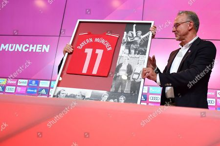 Bayern Munich's president Uli Hoeness (not seen) receives a farewell gift from Bayern's CEO Karl-Heinz Rummenigge (R) during a press conference at the Allianz Arena in Munich, Germany, 30 August 2019. Hoeness announced he will not be available for another term as the president of the club and head of the advisory board.