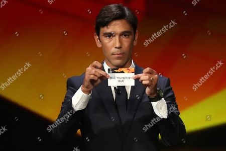 Portuguese former soccer player Paulo Ferreira shows the name of Young Boys during the UEFA Europa League group stage draw at the Grimaldi Forum, in Monaco