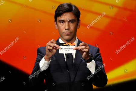 Portuguese former soccer player Paulo Ferreira shows the name of Copenhagen during the UEFA Europa League group stage draw at the Grimaldi Forum, in Monaco