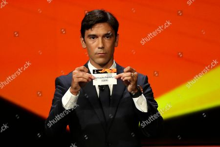 Portuguese former soccer player Paulo Ferreira shows the name of Eintracht Frankfurt during the UEFA Europa League group stage draw at the Grimaldi Forum, in Monaco