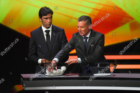 UEFA Head of Club Competitions Michael Heselschwerdt and former Portogues soccer player Paulo Ferreira (L) attend the UEFA Europa League 2019-20 Group Stage draw ceremony in Monaco, 30 August 2019.