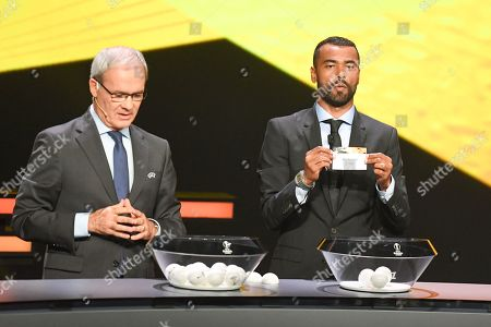 UEFA competitions director Giorgio Marchetti (L) and former English soccer player Ashley Cole attend the UEFA Europa League 2019-20 Group Stage draw ceremony in Monaco, 30 August 2019.